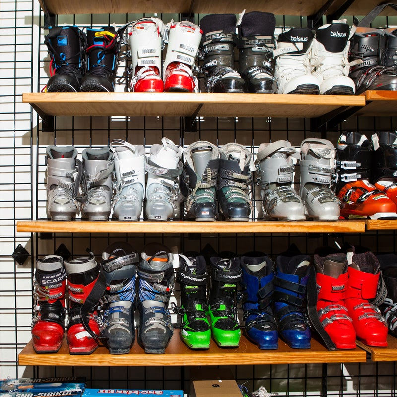Racks of boots, including options from Scarpa and Dynafit, wait for anxious buyers.
