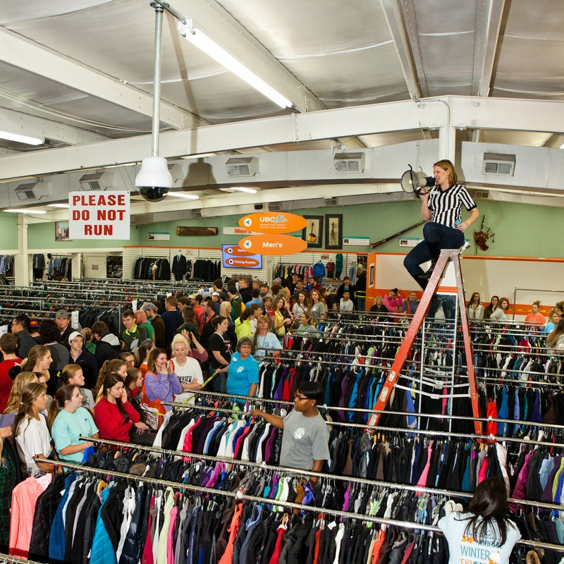 Brenda Cantrell referees the pre-sale excitement, telling customers when they can begin pulling items off of racks. More than half the items were gone in less than 20 minutes after shoppers were allowed in at 8 a.m.