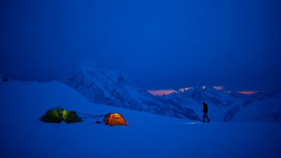 A cold night at 18,000-foot camp: Conrad Anker savoring the last bit of twilight, with 20,000-foot Gangchenpo Peak looming in the background.