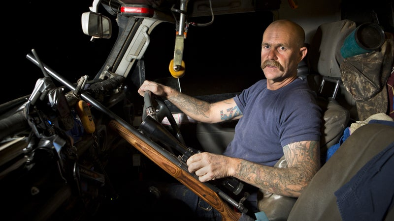 "David ""Cujo"" Coulton in the cab of his truck."