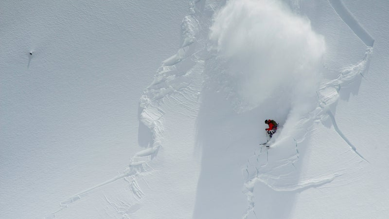 A professional skier setting off a one-foot-deep slab on Mount Baker, in Washington