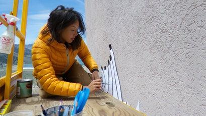 Jane Kim working on her Sierra Nevada Migrating Mural, depicting bighorn sheep.