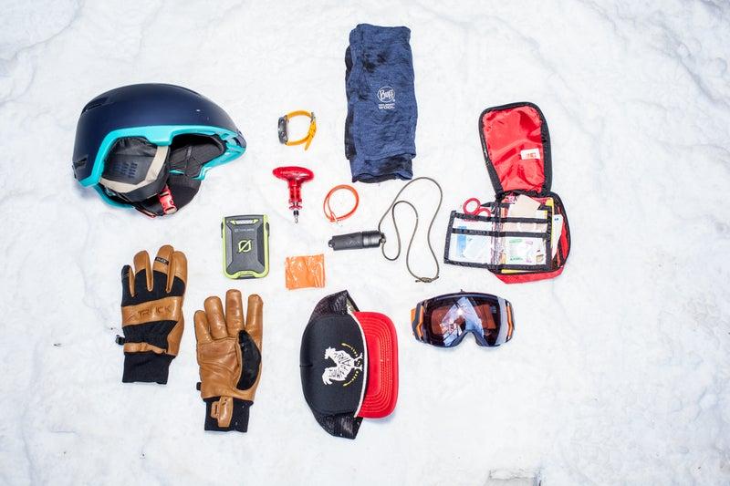 Clockwise from top left: Topo Designs X Giro Edit, Suunto Traverse, Brooks-Range Mountaineering ski binding tool, Voilé strap, merino wool Buff, Exotac Firesleeve, REI first-aid kit, Smith X Owner Operator I/O 7 goggle, Howler Bros mesh-back trucker hat, duct tape, Goal Zero Venture 30, Truck M1 gloves.