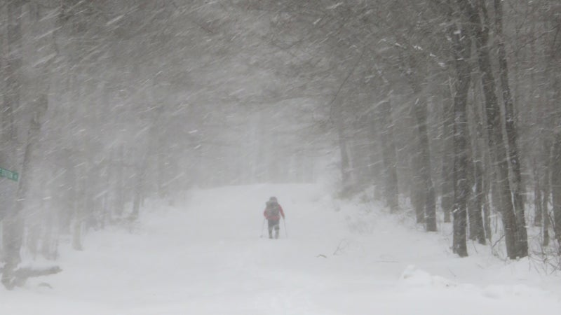 After waiting out a storm near Gorham, NH, Gathman trudges through fresh powder at Crawford Notch to continue south through the White Mountains.