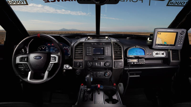 Aside from the addition of a roll cage, racing seats and harnesses, and electronic navigation, communication and telemetry equipment, the interior remains stock, back seat and all.