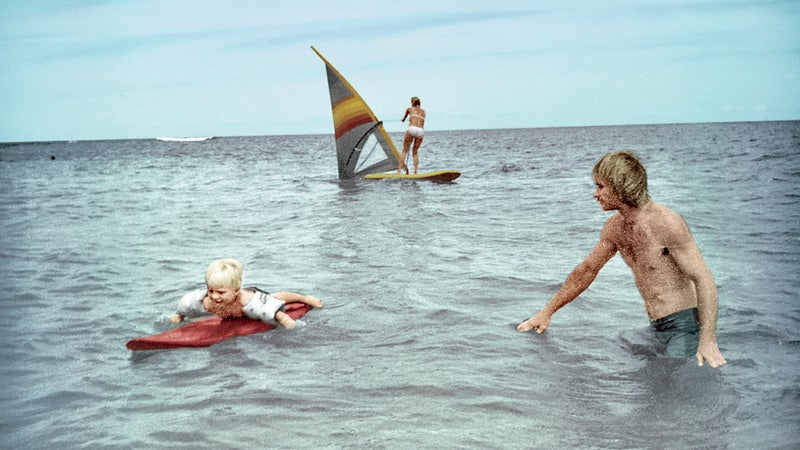 Healey surfing with his father on Oahu, 1982.