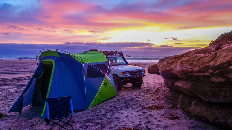 """By far the best car camping tent I've ever used, Nemo's new Wagontop uses a single-wall, external pole design that's super quick to set up, and which gives you vertical walls and a 6'5"""" internal height. With four large, mesh windows, ventilation is excellent, too. Compared to one of those rooftop tents that are so popular on Instagram right now, this thing is larger, more livable, more accessible, and, at $500 and 18 lbs, substantially cheaper and lighter. Don't ruin your vehicle's handling, braking, ride, and fuel economy, use a tent like this."""