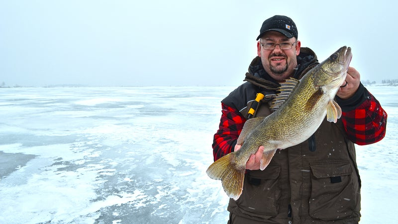 Derrek Sigler with a big walleye.