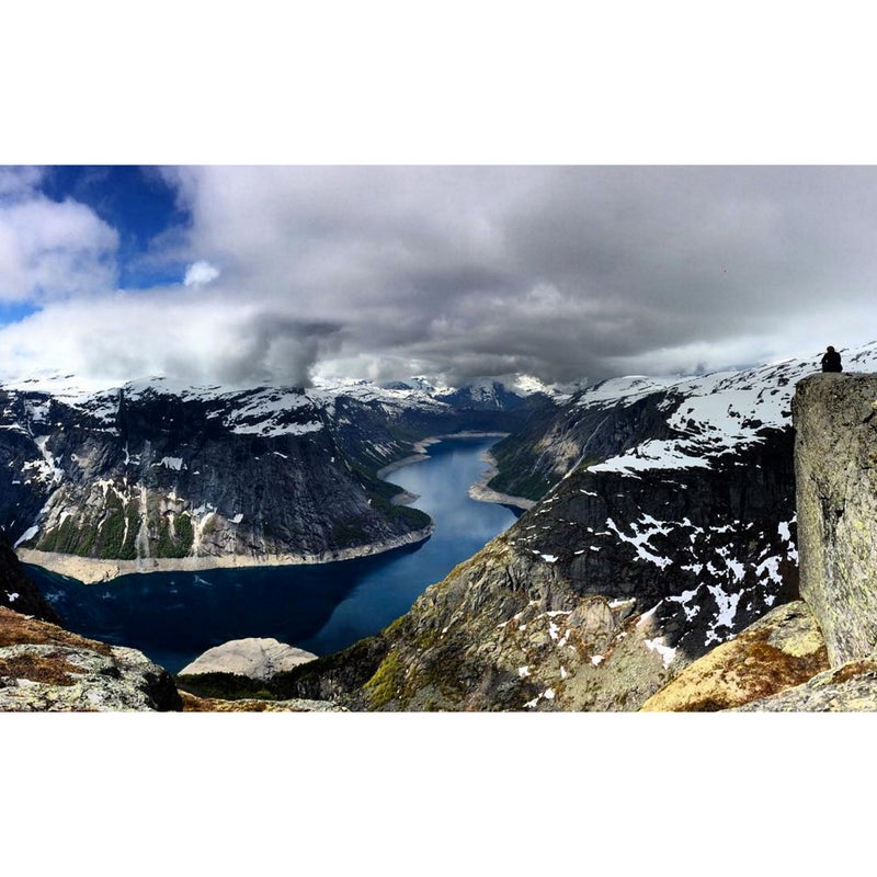 @dagsss: #WhereToTravel is Odda, Norway; more specifically to the Trolltunga hike that ends at this jaw-dropping, breath-taking, and completely humbling view of the Hardangerfjord. The hike is 22 kilometers round-trip. It was snowy when I went in June last year, but that didn't stop all of the hikers from making it to the Troll's tongue itself and basking in the sunlight once we arrived. The views were unreal, so much so that even my iPhone captured what it looked like.