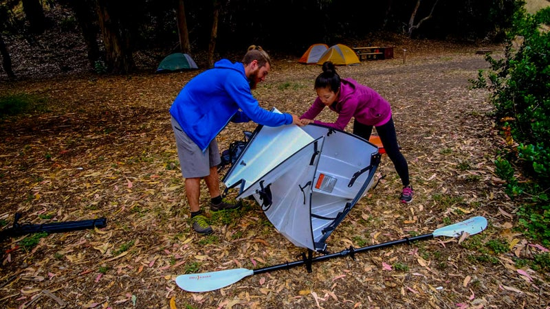 Chris assembles the Oru at Scorpion Bay campground on Santa Cruz Island. The first time is always a bit confusing for new users, but you can do it in 10 minutes after a little practice.