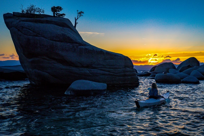 Valerie paddles the Oru on Lake Tahoe at sunset.