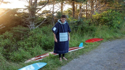 """Want to surf in the PNW? Be prepared to embrace the cold. The weather in the PNW, especially during the Spring and Fall, can change drastically within a few hours, or even minutes. Some people call this thing a """"towel dress."""""""