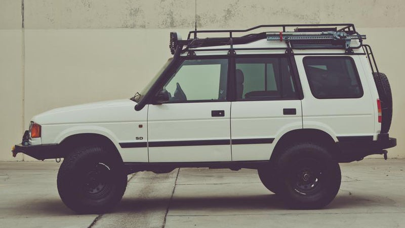 She's a 1999 Land Rover Discovery SD, upgraded for real off-roading, while retaining enough road manners to happily cruise down the highway at 80 MPH.