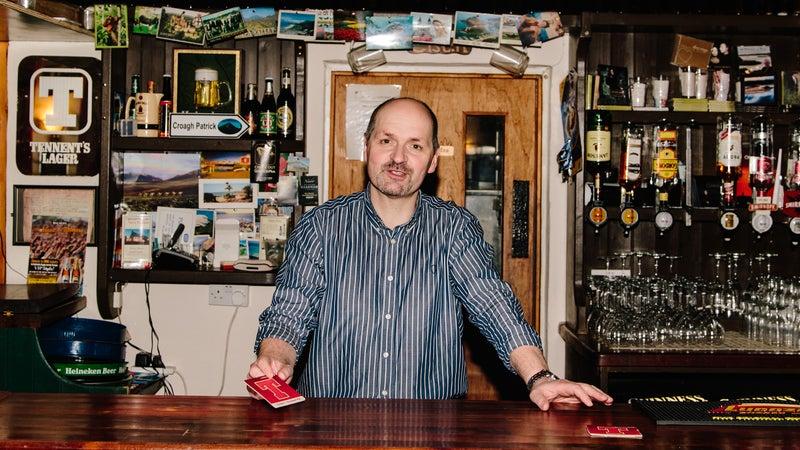 Enya's brother Bartley Brennan tending Leo's Tavern in Meenaleck.