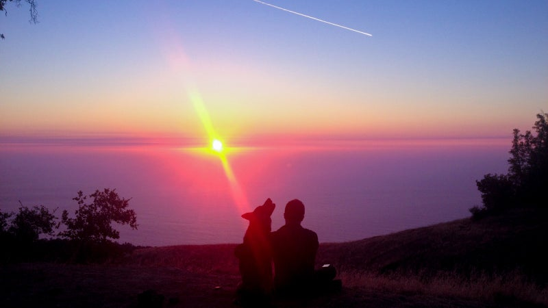 Wes and Wiley watch the sunset from Big Sur's Prewitt Ridge.