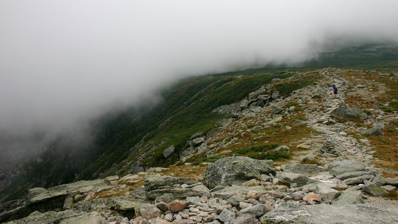 An easy portion of Lion's Head Trail. Note the loose boulders, the steep drop off, and the cairns.
