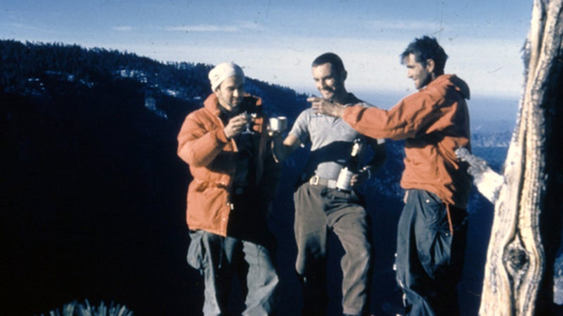 George Whitmore, Wayne Merry, and Warren Harding toast each other on the summit of the Nose. November 1958.