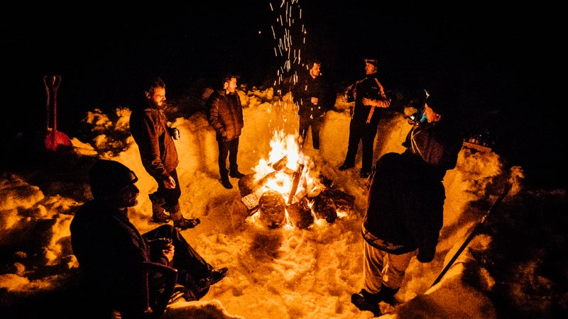 Just some dudes, a campfire, and an Alaskan winter.