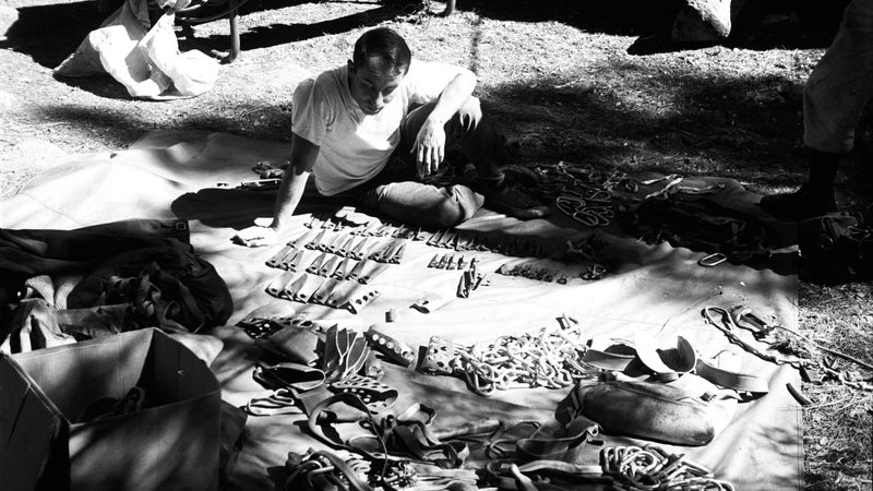 Yvon Chouinard selecting pitons at Camp Four in 1964.
