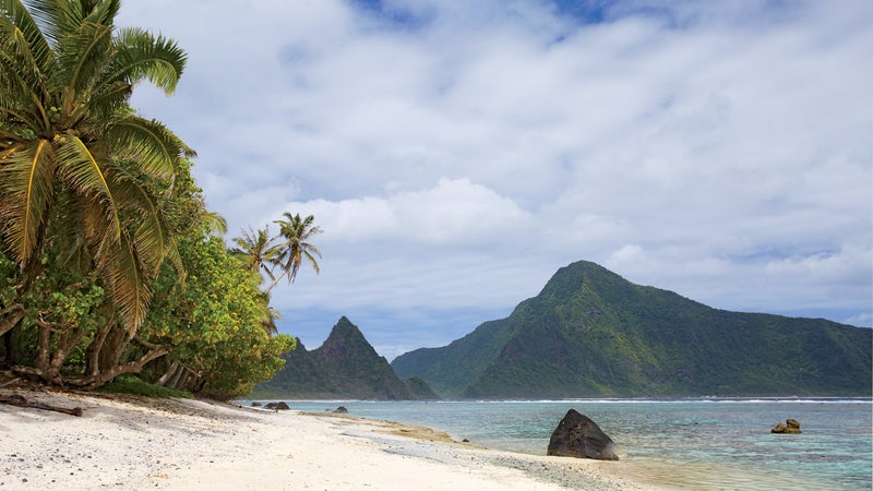 A stretch of the coastline on Ofu, part of the National Park of American Samoa, with the island of Olosega just beyond.