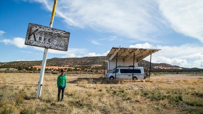 A rare pause in the action: Brody and their RV at a classic American roadside attraction.