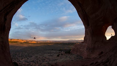 After some climbing, the group headed to a sandstone arch just south of Moab where they watched the sunset while swinging from a 100-foot rope anchored to climbing bolts.