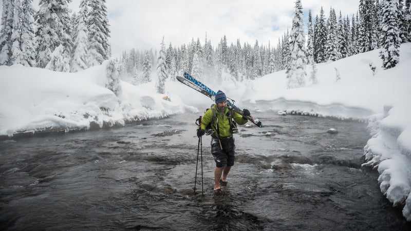 """""""We realized we could have a crazy adventure in our own backyard and see pristine wilderness that very few people have seen in the wintertime,"""" says Jackson, Wyoming, photograhper Taylor Glenn. After Glenn and wildlife biologist Taylor Phillips brainstormed travel ideas, the two decided to try a 32-mile cross-country ski tour from Old Faithful to Yellowstone's Bechler Ranger Station last February. In addition to crossings like the Ferris Fork, the six-day journey involved dragging a sled through deep, unpacked snow, fully loaded. """"It was a battle,"""" Glenn says, """"but it was worth it."""" THE TOOLS: Nikon D750, 24-70mm f/2.8 lens, ISO 100, f/2.8, 1/3,200 second"""