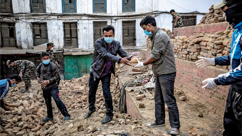 Salvaging ancient bricks in Patan Durbar Square, a Unesco World-Heritage site, last May