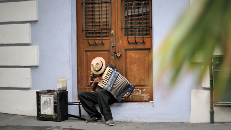 A plan plays an accordion in old San Juan.