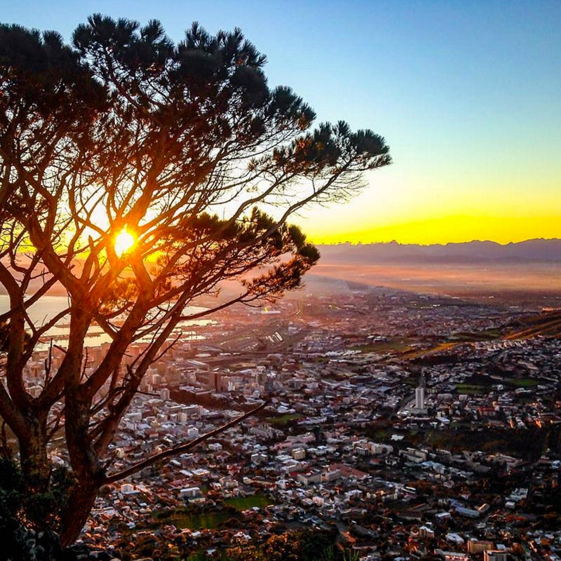 """""""Sun rise from the top of Lions Head. The light along the coast and against the surrounding mountains is more then worth the early rise. #southafrica #lionshead #capetown"""""""