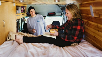 Eli Meir Kaplan/Wonderful Machine for OutsideJohn Stifter and Janna Irons pose with their Dodge Sprinter van on Thursday, March 14, 2016 at Shenandoah National Park in Virginia.