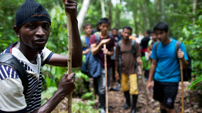 Gambian Morro Kanteh with fellow migrants from Bangladesh and Nepal in the Darién Gap.