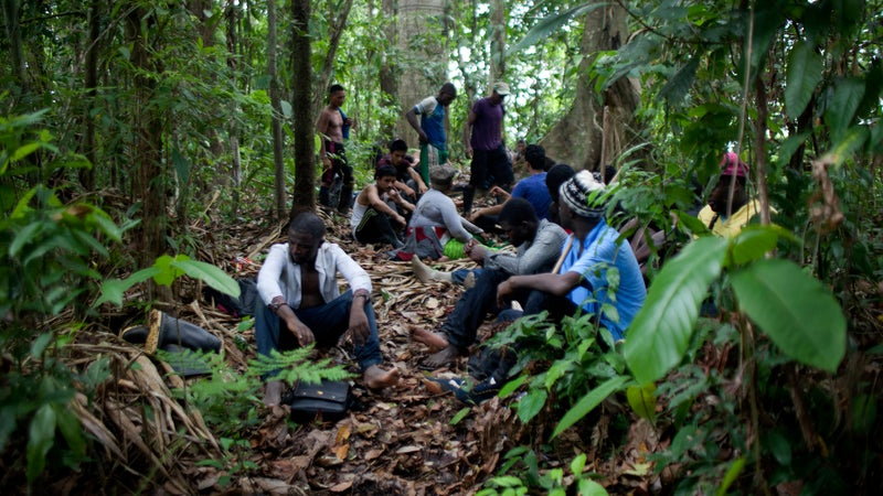 Migrants resting in the jungle.