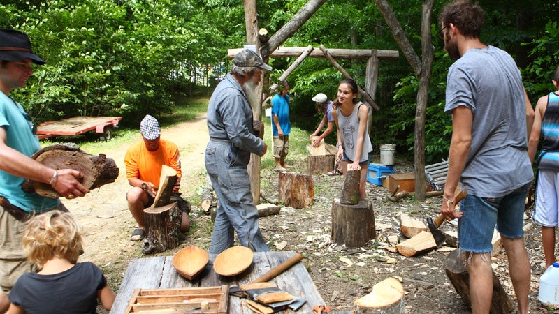 Firefly Gathering participants learned skills including how to carve dishes, chop wood, and build fires.