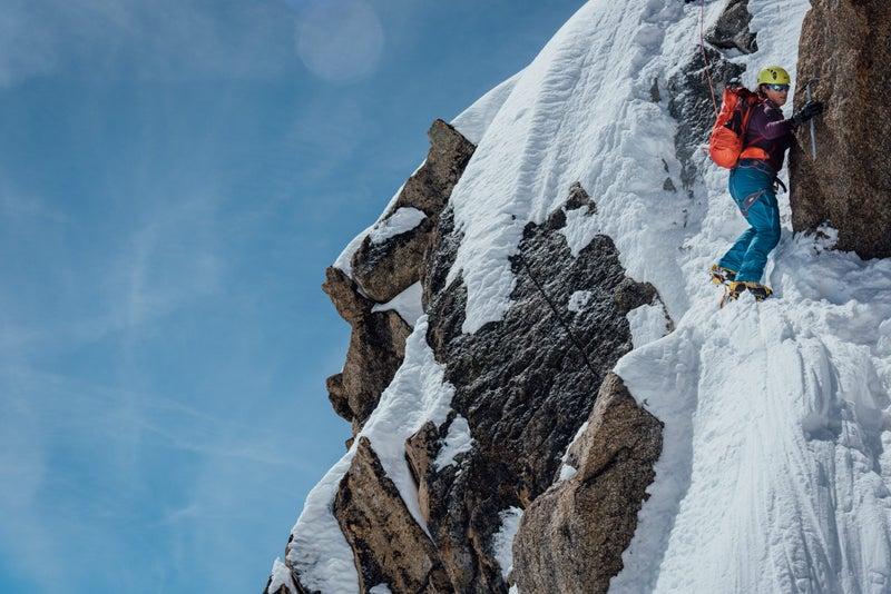 A climber ascends the Arête des Cosmiques.