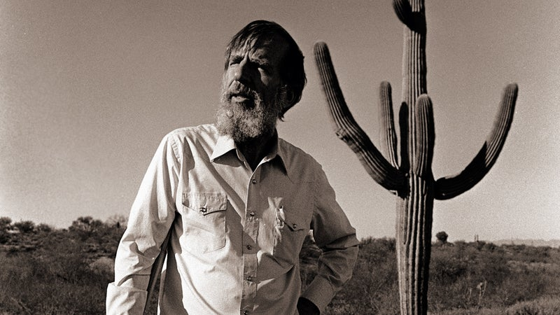 """Edward Abbey in 1987, two years before his death. """"I want my body to help fertilize the growth of a cactus or cliff rose or sagebrush or tree,"""" he'd written."""