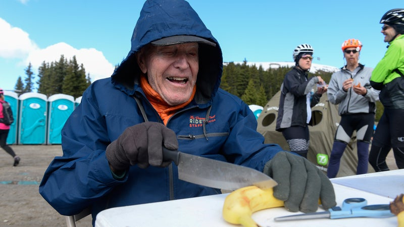 FREMONT PASS, CO - JUNE 14:  Don Siekmeier of Denver cuts bananas for riders at an Aid Station during day three of the 31st annual Ride the Rockies on June 14, 2016. Ride the Rockies cyclists  rode the Copper Triangle 79 miles through Leadville and the Vail Pass. (Photo by Michael Reaves/The Denver Post via Getty Images)