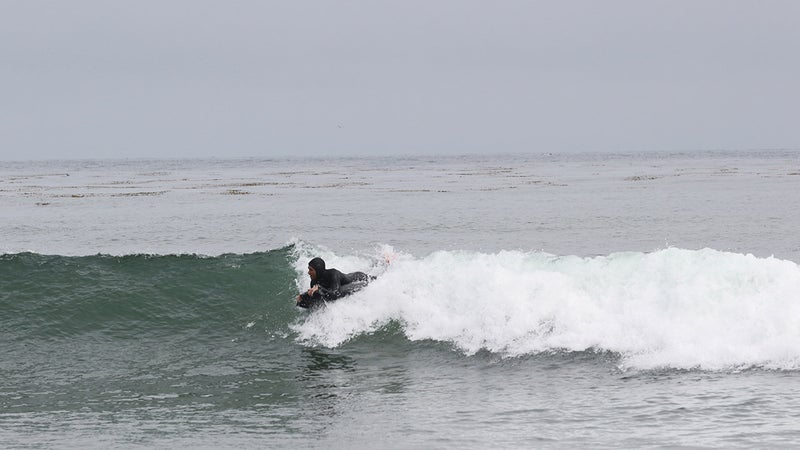 Justin catches a wave. It's not pretty, but it is effective.