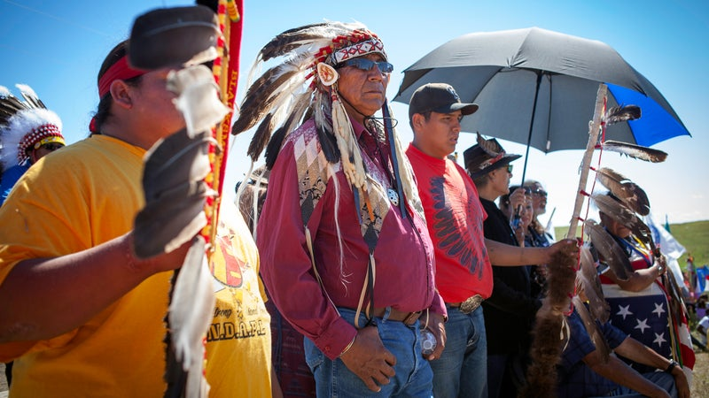 Chief Arvol Looking Horse, leader of the Lakota Sioux Nation stands nearby Apache musician Robby Romero and AIM co-founder Dennis Banks witnessing a drum-circle near the construction blockade at Standing Rock. 8/27/16