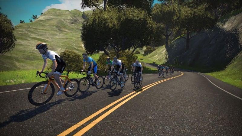 Zwift riders head uphill on Watopia.