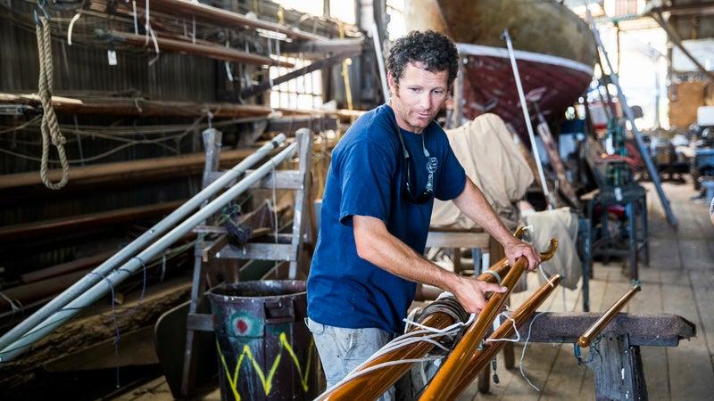 Christian Langendal works on a boat.