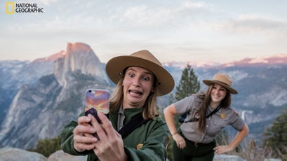 At Yosemite's Glacier Point, rangers Diana del Solar and Christina Warburg pose for a selfie to post to a Department of the Interior Snapchat account.
