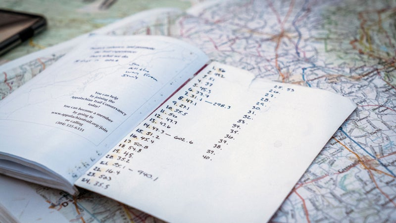 A trail map and progress notebook, seen during Karl Meltzer's attempt to break the record for running the length of the Appalachian Trail on 27 August, 2016. // Interpret Studios / Red Bull Content Pool // P-20160829-01421 // Usage for editorial use only // Please go to www.redbullcontentpool.com for further information. //