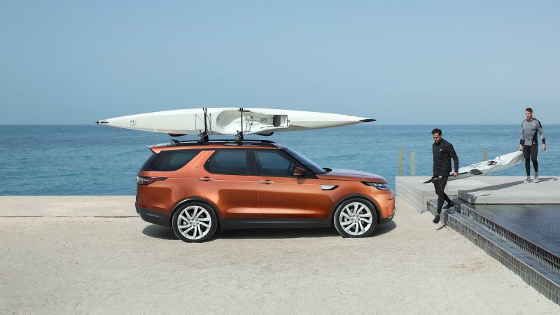 The new Discovery can lower its optional air suspension to make loading items onto its roof much easier.