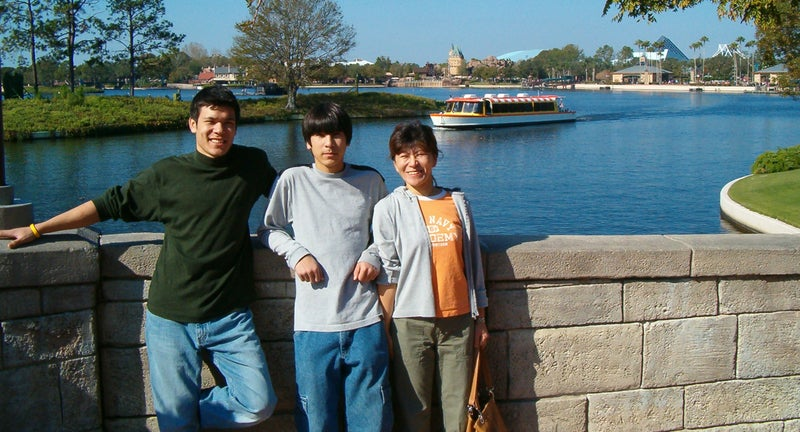 David Fry, center, with his brother, Daniel, and mother, Sachiyo, during a family trip to Disney World.