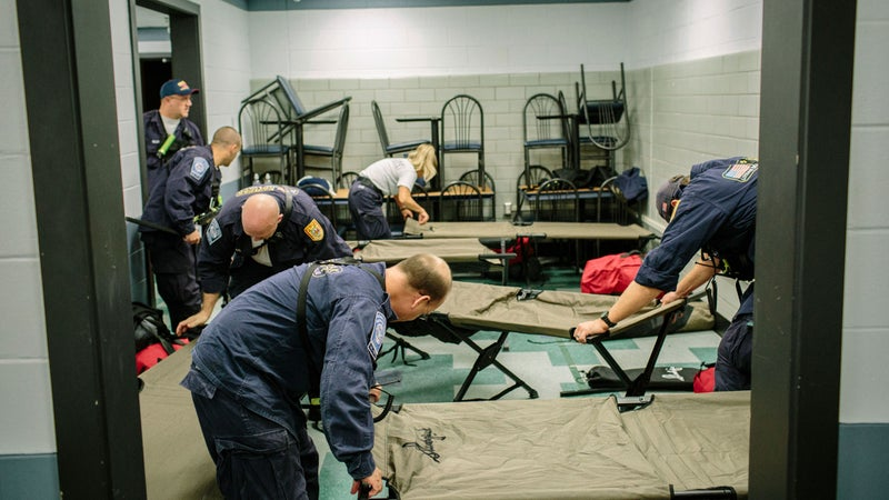Setting up cots at Hunter Army Airfield.