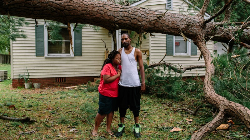 A large tree fell in front of Shantea and Malcolm Craig's house in a suburb of Savannah while they slept inside their bedroom at the front of the house. The tree missed them by a few feet.