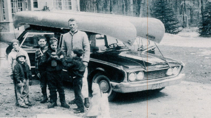 The author (at far left) with his father, his sister Kate (fourth from left), and his cousins, near Pine Lake.