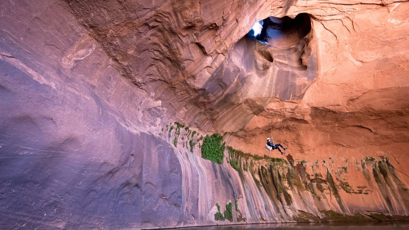 Joey Schusler rapelling into the Golden Cathedral.