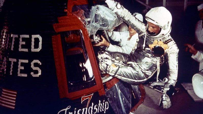 Astronaut John Glenn enters the Mercury spacecraft, Friendship 7, prior to the launch of MA-6 on February 20, 1961 and became the first American who orbited the Earth. The MA-6 mission was the first manned orbital flight boosted by the Mercury-Atlas vehicle, a modified Atlas ICBM (Intercontinental Ballistic Missile), lasted for five hours, and orbited the Earth three times.
